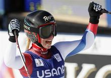 Lara Gut of Switzerland celebrates in the finish area after winning the women's World Cup Super-G ski race in Beaver Creek, Colorado, November 30, 2013. REUTERS/Rick Wilking
