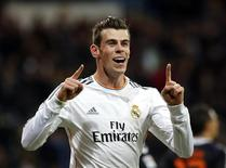 Real Madrid's Gareth Bale celebrates his goal against Real Valladolid during their Spanish First Division soccer match at Santiago Bernabeu stadium in Madrid November 30, 2013. REUTERS/Susana Vera