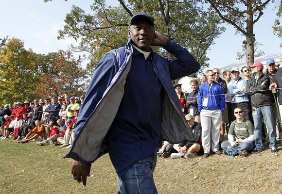Former Chicago Bulls basketball player Michael Jordan walks along the 11th fairway during the morning foursomes round at the 39th Ryder Cup matches at the Medinah Country Club in Medinah, Illinois, September 28, 2012. REUTERS/Jeff Haynes/Files