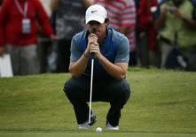 Northern Ireland's Rory McIlroy leans on his putter on the eighth hole during the second round of the Australian Open golf tournament at Royal Sydney Golf Club November 29, 2013. REUTERS/David Gray