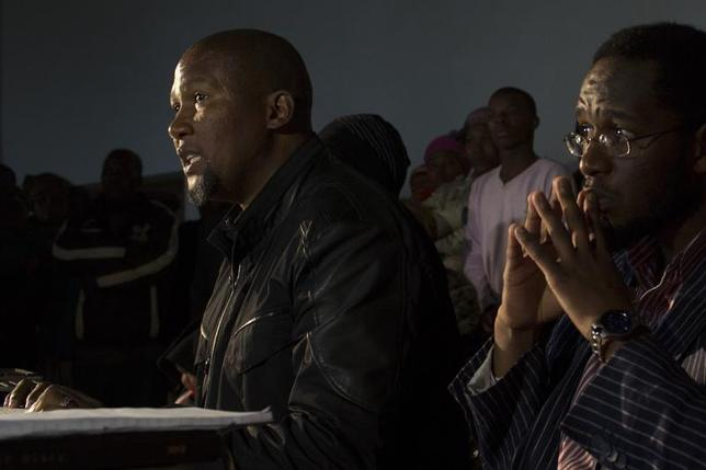 Mandla Mandela (L), grandson of former South African president Nelson Mandela, talks to journalists during a news conference in Mvezo, in the Eastern Cape of South Africa, July 4, 2013, a day after a court order to return the bodies of three of Mandela's children to Qunu was carried out. REUTERS/Siegfried Modola