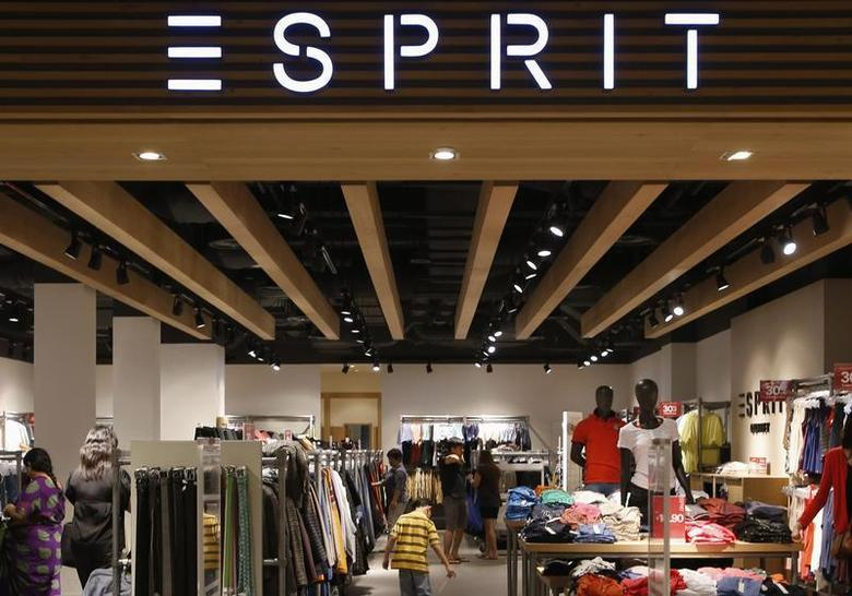 People shop at an Esprit Outlet store in Singapore September 10, 2013. REUTERS/Edgar Su
