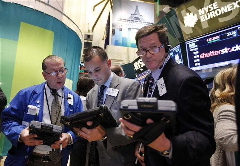 Traders work in front of a trading board showing Shutterstock Inc on the floor of the New York Stock Exchange, October 11, 2012. REUTERS/Brendan McDermid