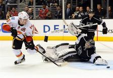 Nov 30, 2013; Los Angeles, CA, USA; Calgary Flames left wing Mike Cammalleri (13) scores the game winning goal past Los Angeles Kings goalie Ben Scrivens (54) in the third period of the game at Staples Center. Flames won 2-1. Jayne Kamin-Oncea-USA TODAY Sports