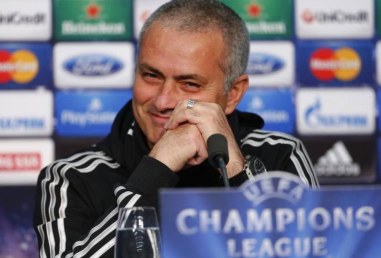 Chelsea manager Jose Mourinho smiles as he addresses a news conference in Basel November 25, 2013. Chelsea will play against Basel in the Champions League group stage on Tuesday. REUTERS/Arnd Wiegmann