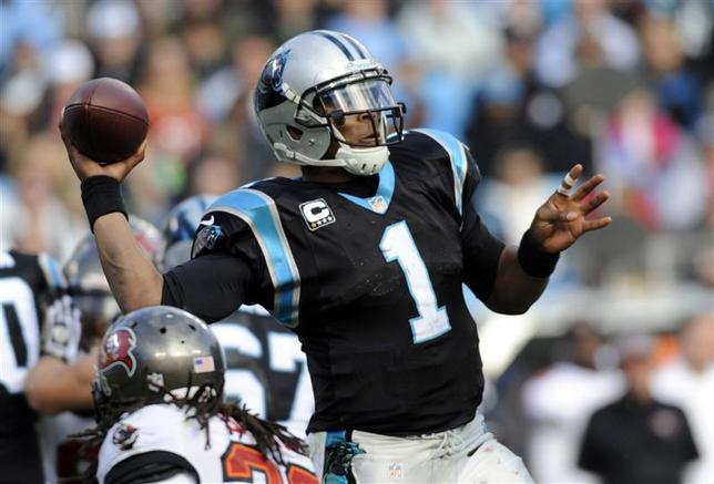Dec 1, 2013; Charlotte, NC, USA; Carolina Panthers quarterback Cam Newton (1) drops back to pass during the second half of the game against the Tampa Bay Buccaneers at Bank of America Stadium. Carolina wins 27-6. Sam Sharpe-USA TODAY Sports