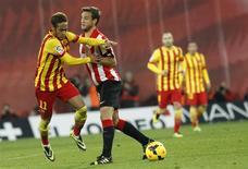 Barcelona's Neymar (L) is challenged by Athletic Bilbao's Carlos Gurpegui (2nd L) during their Spanish first division soccer match at San Mames stadium in Bilbao December 1, 2013. REUTERS/Joseba Extaburu