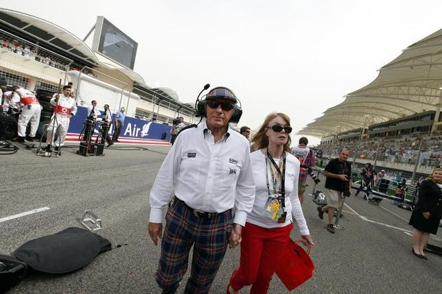 Former Formula One champion Sir Jackie Stewart walks in the grid with his wife Helen before the Bahrain F1 Grand Prix at the Sakhir circuit in Manama April 22, 2012. REUTERS/Hamad I Mohammed