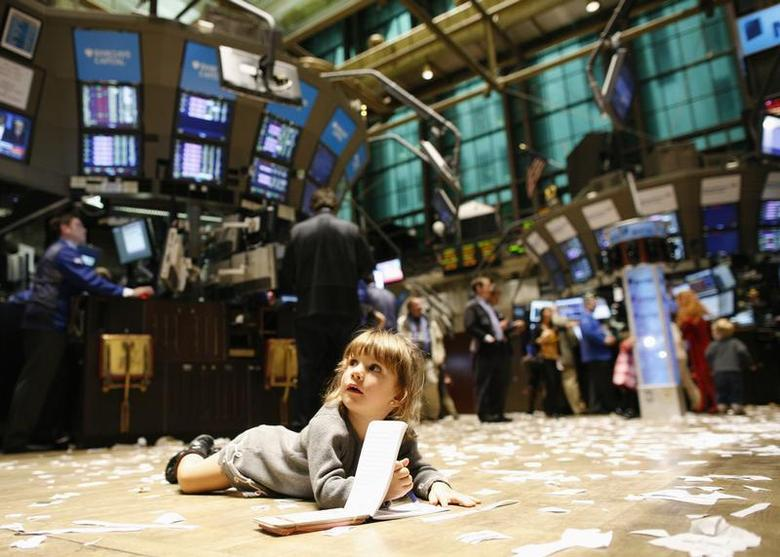 A child lies on the trading floor, during kid's day at the New York Stock Exchange November 27, 2009. REUTERS/Brendan McDermid