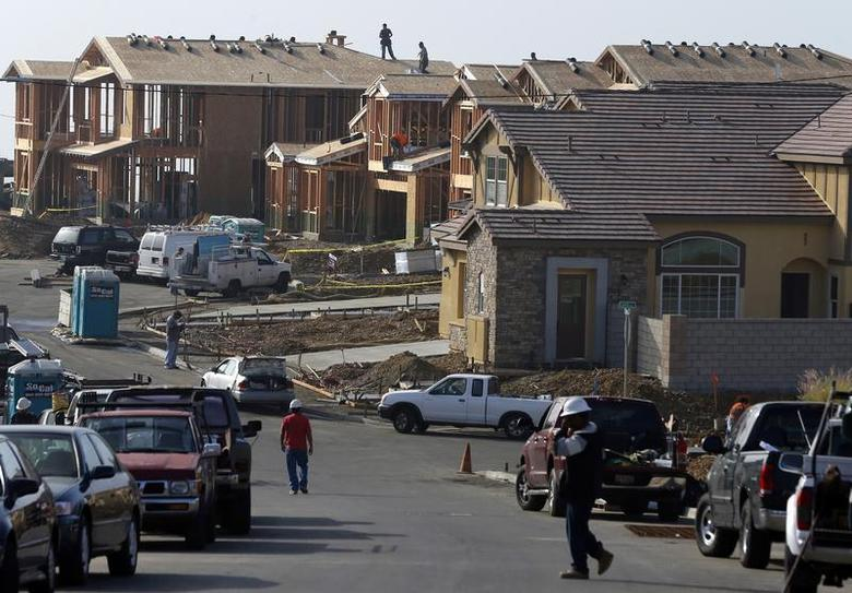 People walk near new single family homes under construction in San Marcos, California October 25, 2013. REUTERS/Mike Blake
