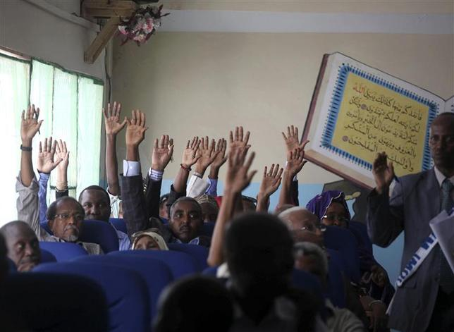 Members of the Somali parliament vote by a show of hands in Mogadishu December 2, 2013. REUTERS/Ismail Taxta