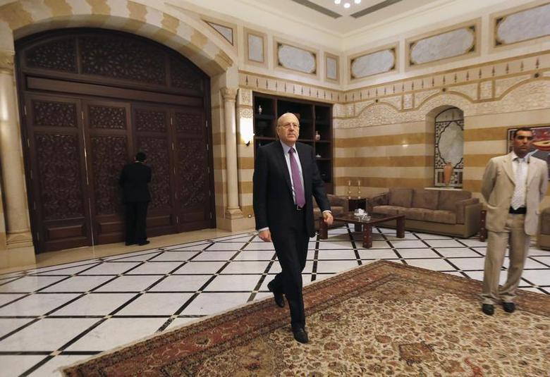 Lebanon's Prime Minister Najib Mikati walks at the Grand Serail, the government headquarters in Beirut March 12, 2013. REUTERS/Jamal Saidi