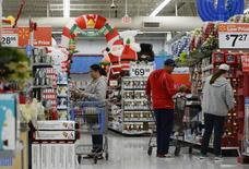 Customers shop for Christmas ornaments at a Walmart store in the Porter Ranch section of Los Angeles November 26, 2013. REUTERS/Kevork Djansezian