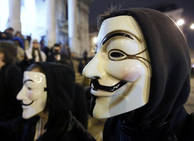 A protester wearing a Guy Fawkes mask, symbolic of the hacktivist group ''Anonymous'', takes part in a protest in central Brussels January 28, 2012. REUTERS/Yves Herman