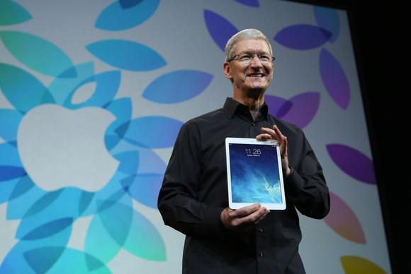Apple Inc CEO Tim Cook holds up the new iPad Air during an Apple event in San Francisco, California October 22, 2013. REUTERS/Robert Galbraith