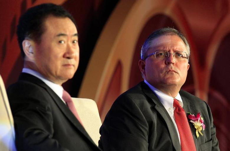 Gerry Lopez (R), chief executive of AMC Entertainment, listens to a question next to Wang Jianlin, president of Wanda Group, during a media conference after an official signing ceremony in Beijing May 21, 2012. REUTERS/David Gray