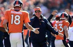 Oct 13, 2013; Denver, CO, USA; Denver Broncos head coach John Fox reacts to the touchdown pass by quarterback Peyton Manning (18) to wide receiver Wes Welker (83) in the first quarter against the Jacksonville Jaguars at Sports Authority Field at Mile High. Ron Chenoy-USA TODAY Sports