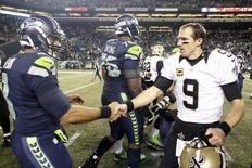 Dec 2, 2013; Seattle, WA, USA; Seattle Seahawks quarterback Russell Wilson (3) and New Orleans Saints quarterback Drew Brees (9) shake hands following a 34-7 Seattle victory at CenturyLink Field. Mandatory Credit: Joe Nicholson-USA TODAY Sports