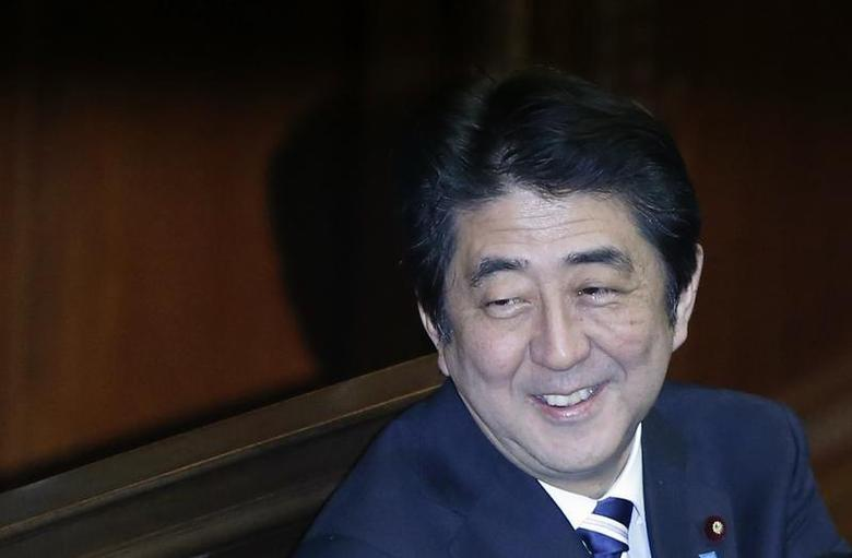 Japan's Prime Minister Shinzo Abe smiles during the Lower House plenary session of the parliament in Tokyo November 26, 2013. REUTERS/Toru Hanai