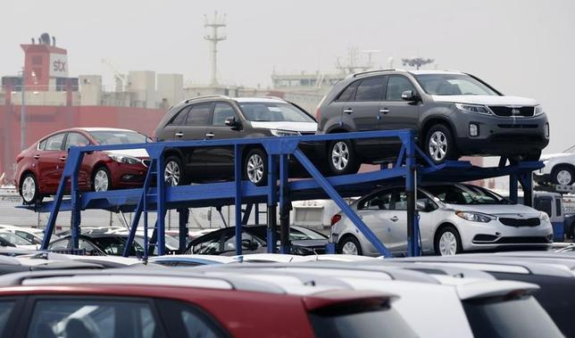 A truck transports cars made by South Korea's Hyundai Motor Group at the company's shipping yard at a port in Pyeongtaek, about 70 km (43 miles) south of Seoul July 25, 2013. REUTERS/Lee Jae-Won