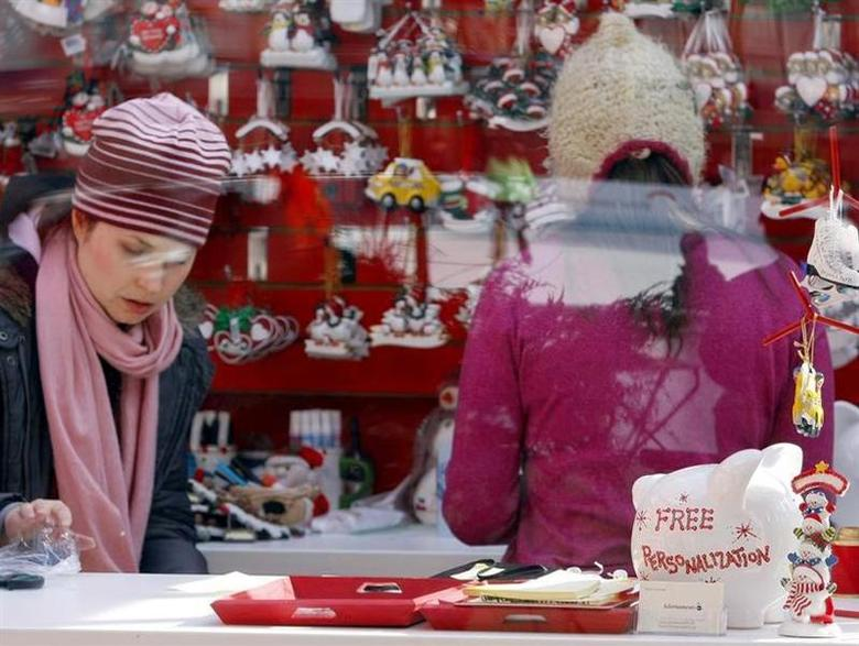 A free personalization promotion is seen inside a holiday-themed store in New York's Bryant Park November 24, 2008. REUTERS/Shannon Stapleton