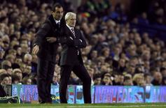 Everton's manager Roberto Martinez (L) gestures as his Stoke City counterpart Mark Hughes looks on during their English Premier League soccer match at Goodison Park in Liverpool, northern England November 30, 2013. REUTERS/Phil Noble