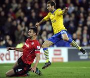 Arsenal's Mathieu Flamini (R) scores a goal against Cardiff City during their English Premier League soccer match at Cardiff City Stadium in Cardiff, Wales, November 30, 2013. REUTERS/Rebecca Naden