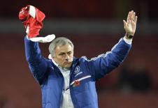 Chelsea's manager Jose Mourinho reacts after their English League Cup fourth round soccer match against Arsenal at Emirates Stadium in London, October 29, 2013. REUTERS/Toby Melville