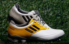 """Adidas golf shoes """"Adizero"""" are pictured during the company's annual news conference in Herzogenaurach in this March 7, 2013 file picture. REUTERS/Michael Dalder/Files"""