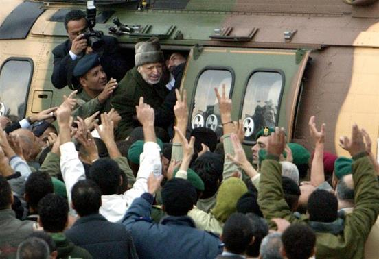 Former Palestinian President Yasser Arafat (C) enters a helicopter as he leaves his compound in the West Bank city of Ramallah, in this October 29, 2004 file picture. REUTERS-Ammar Awad-Files