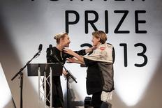 French-born film installation artist Laure Prouvost (R) embraces Irish actress Saoirse Ronan after Ronan awarded Prouvost with this year's Turner Prize, in Londonderry, Northern Ireland December 2, 2013. RREUTERS/robertemmett.co.uk/City of Culture 2013/Handout via Reuters