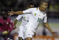 Argelino Sofiane Feghouli comemora gol marcado contra Benin nas eliminatórias africanas para a Copa do Mundo de 2014. 26/03/2013 REUTERS/ Louafi Larbi