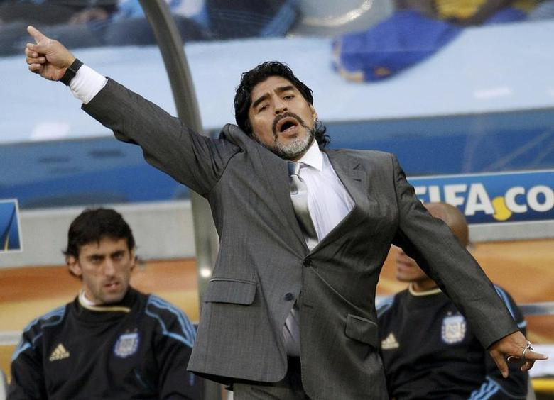 Argentina's coach Diego Maradona gestures during their 2010 World Cup quarter-final soccer match against Germany at Green Point stadium in Cape Town July 3, 2010. REUTERS/Darren Staples