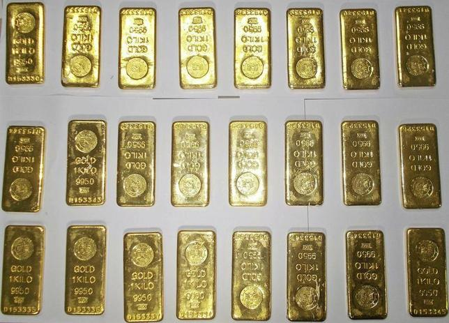 Seized gold bars are kept on displayed by custom officers at the international airport in Kolkata November 19, 2013. REUTERS/Stringer/Files