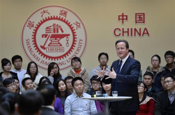 British Prime Minister David Cameron gestures as he delivers a speech to students during his trip in China at Shanghai Jiao Tong University in Shanghai, December 3, 2013. REUTERS/China Daily