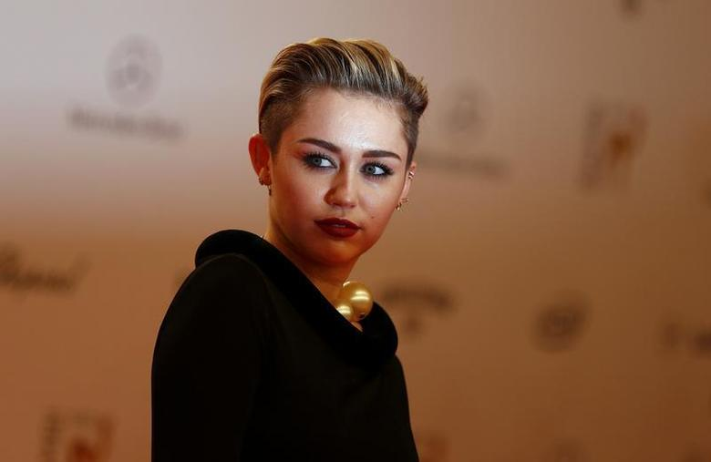U.S. singer singer Miley Cyrus arrives on the red carpet for the Bambi 2013 media awards ceremony in Berlin November 14, 2013. REUTERS/Tobias Schwarz
