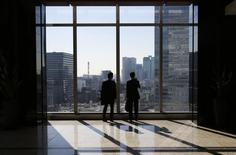 Businessmen are seen inside a high-rise office building in Tokyo November 21, 2013. REUTERS/Issei Kato