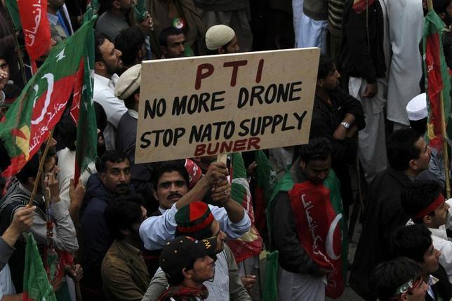 Supporters of the Pakistan Tehreek-e-Insaf (PTI) political party of former cricket star Imran Khan protest during a rally to stop NATO supply routes into Afghanistan and drone attacks, in Peshawar November 23, 2013. REUTERS/Fayaz Aziz