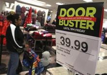 A Black Friday sale advertisement is posted inside a J.C. Penney store at the Glendale Galleria in Glendale, California November 29, 2013. REUTERS/Jonathan Alcorn