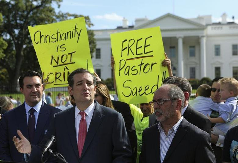 U.S. Senator Ted Cruz (R-TX) (C) delivers his remarks with members of the Christian Defense Coalition in front of the White House in Washington September 26, 2013. The event marked the one year anniversary of Saeed Abedini, an Iranian American pastor who is serving eight years in an Iranian prison. REUTERS/Gary Cameron