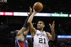 Dec 2, 2013; San Antonio, TX, USA; San Antonio Spurs forward Tim Duncan (21) drives to the basket as Atlanta Hawks forward Paul Millsap (left) defends during the first half at AT&T Center. Soobum Im-USA TODAY Sports