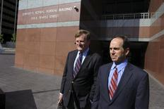 Former KPMG senior auditor Scott London (R) and his lawyer Harland Braun leave the Roybal Federal Court Building after London's hearing in downtown Los Angeles April 11, 2013. REUTERS/David McNew