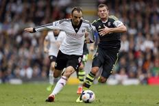 Fulham's Dimitar Berbatov (L) challenges Stoke City's Erik Pieters during their English Premier League soccer match at Craven Cottage in London October 5, 2013. REUTERS/Stefan Wermuth