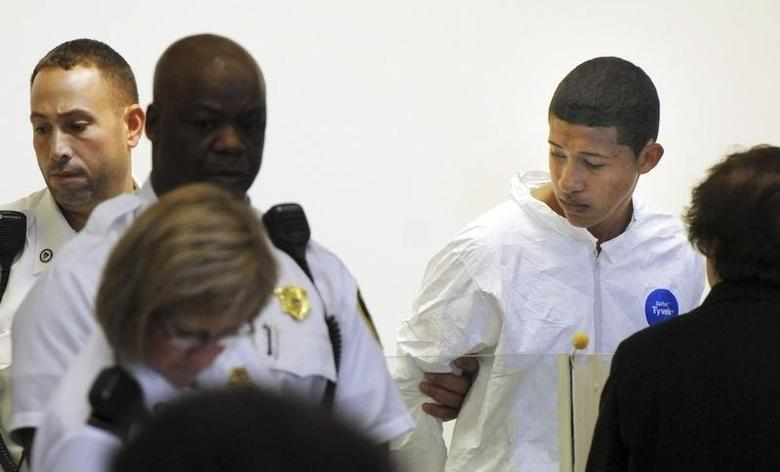 Philip Chism, 14, stands during his arraignment for the death of Danvers High School teacher Colleen Ritzer in Salem District Court in Boston, Massachusetts October 23, 2013. REUTERS/Patrick Whittemore/Pool