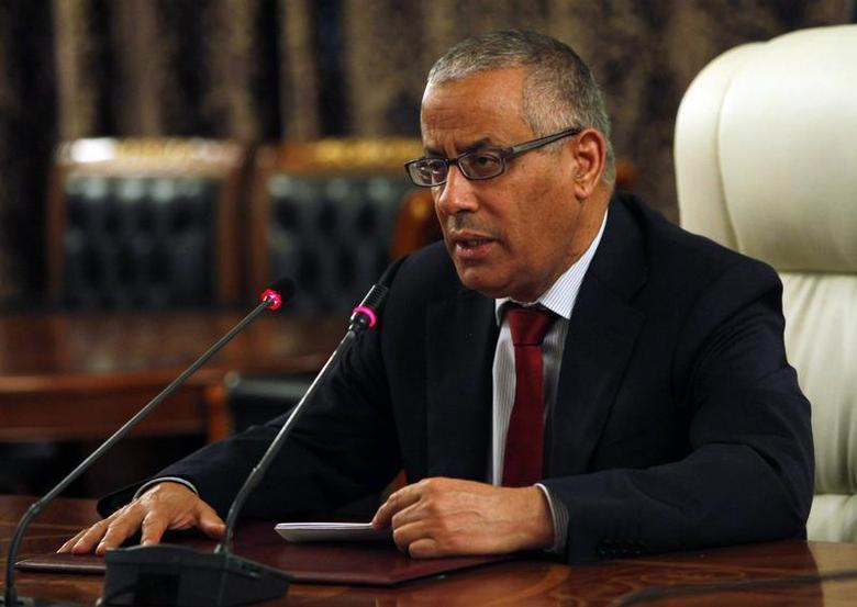 Libya's Prime Minister Ali Zeidan speaks during a news conference at the Prime Minister's Office in Tripoli October 30, 2013. REUTERS/Ismail Zitouny