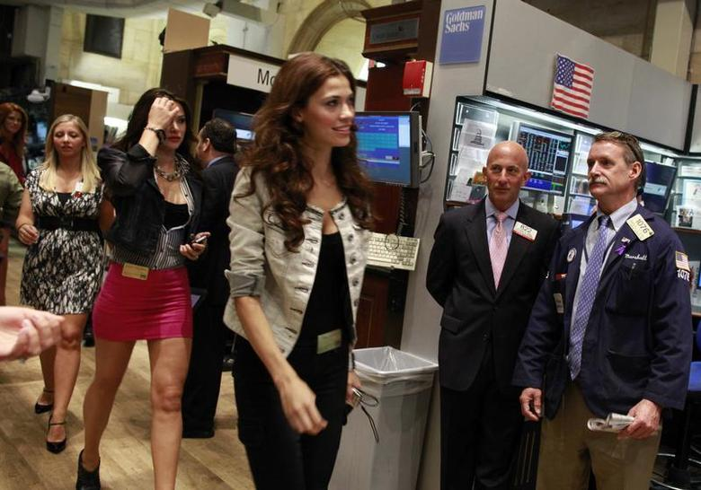 Traders watch as models from Guess? walk on the floor of the New York Stock Exchange, August 31, 2010. REUTERS/Brendan McDermid