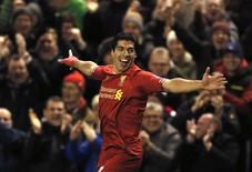 Liverpool's Luis Suarez celebrates scoring a goal against Norwich during their English Premier League soccer match at Anfield in Liverpool, northern England, December 4, 2013. REUTERS/Phil Noble
