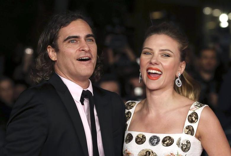 Cast members Joaquin Phoenix (L) and Scarlett Johansson (R) arrive for a red carpet event for the movie ''Her'' at the Rome Film Festival, November 10, 2013. REUTERS/Alessandro Bianchi