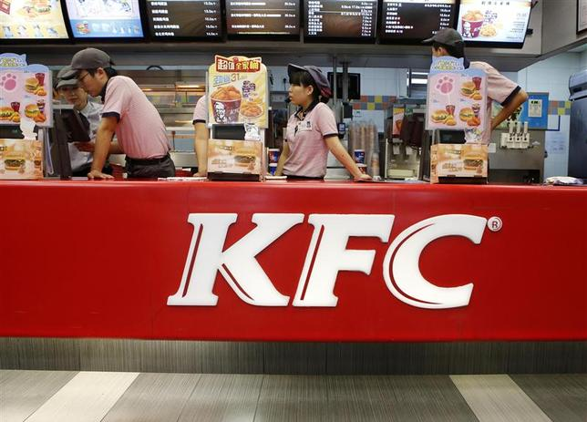 KFC's staff wait for customers at its restaurant in Beijing in this October 9, 2013 file photograph. REUTERS/Kim Kyung-Hoon