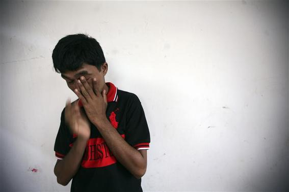 Bozor Mohammed from the Rakhine state in Myanmar stands near a wall after an interview at his house in Kuala Lumpur November 8, 2013. Picture taken November 8. REUTERS-Samsul Said
